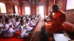 Visaka Bucha day . student Listen to sermon in Buddhist temple - stock footage