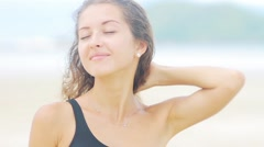 Happy pretty young woman smiling and touching her hair Stock Footage