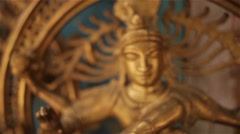 A day in the life of India - common bronze Shiva sculpture Stock Footage