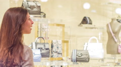 Young Woman Looking Through Shop Window At Fancy Fashion Bags Brands Shopping Stock Footage
