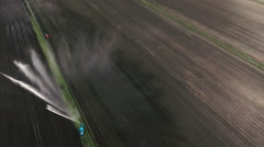 Aerial view:Irrigation system watering a farm field - stock footage