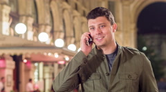 Happy Young Man Walking Through Milan Talking On Cellphone Smiling Vacation In Stock Footage