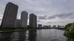 Time-lapse footage of cloudy sky over Tokyo cityscape before sunset, Tokyo Stock Footage