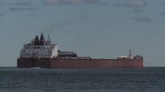 Great Lakes Freighter Departing Duluth Harbor III - stock footage