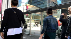 People line up for waiting bus at downtown Vancouver - stock footage