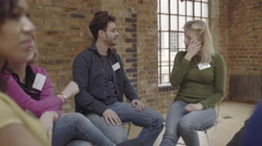 Couple making up and talking during group therapy session Stock Footage
