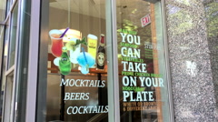 You can take on your plate sign on glass of restaurant at downtown Vancouver Stock Footage