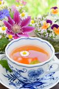 Tea break with flowers Stock Photos