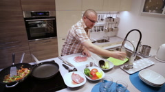 Man Salt and Pepper Meat, Pouring Oil on Pan - stock footage