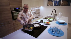Man Prepares Vegetables and Roast Meat Stock Footage