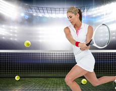 Composite image of athlete playing tennis with a racket - stock photo