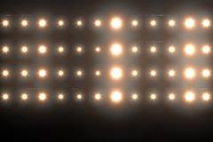 Composite image of orange spotlight against black background Stock Illustration