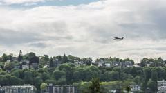 A seaplane or biplane flys through the sky over Downtown Seattle, Washington Arkistovideo