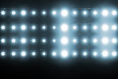 Digitally generated image of blue spotlight - stock illustration