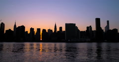 New York City Manhattan evening sunset buildings skyline at Manhattanhenge Stock Footage