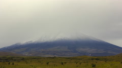Cotopaxi Volcano time-lapse. Emerging from the mist after a fresh snowfall. - stock footage
