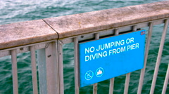 No Jumping or Diving From Pier sign in Coney Island New York during Summer Stock Footage