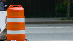 Orange Safty Drum on the street in Brooklyn New York during the day Stock Footage