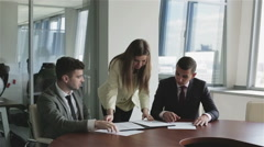 The staff of the publishing agency at work. A business team. Stock Footage