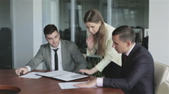 Team leader woman in yellow jacket is talking with a colleagues at meeting room. Stock Footage