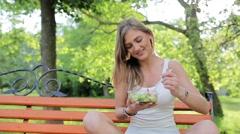 Girl eating salad  Stock Footage