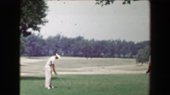 1968: Young strong man driving golf ball as friends watch with closeup extra. - stock footage