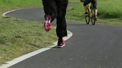 Cyclist riding and Road runner Male Legs Feet Running. Sports lifestyle-Dan Stock Footage