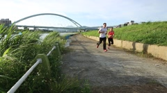 Man and woman running near the river in Taipe city. Sports lifestyle-Dan - stock footage
