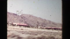 1968: Driving in southwestern USA dry desert landscape passing classic 1940s Stock Footage