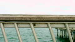 Railing on the Coney Island Pier in New York during the summer Stock Footage