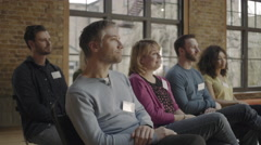 Group adults applauding speaker at event Stock Footage