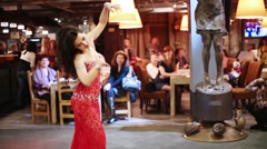 Woman in dress dancing, turning and bowing in hall cafe Rukav Stock Footage