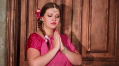 Woman with flowers in hair clasping hands in prayer. Stock Footage