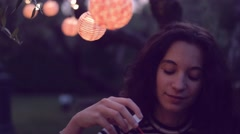Young woman having fun with soap bubbles Stock Footage