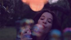 Young woman having fun with soap bubbles - stock footage