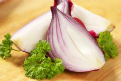 Red onion cut into wedges Stock Photos