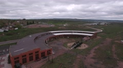 An aerial shot of train depot and roundhouse Stock Footage