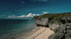Clean white beach secluded with cliffs viewed from above - Geger beach, Bali Stock Footage