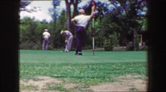 1968: Man long golf putt caddie tends pin ball comes up short. PALM SPRINGS, - stock footage