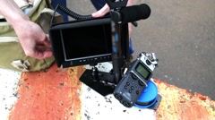 Display, stick and steadicam device for stabilizing video close up shots Stock Footage