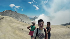 Happy family taking selfie photo on Ijen volcano rim in Java, Indonesia Stock Footage
