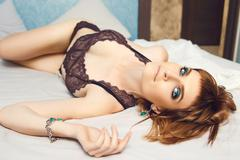 Beautiful dark blonde sexy girl in lace lingerie - stock photo