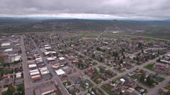 Cool aerial shot over houses in a suburb city neighborhood Stock Footage