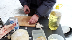Preparation of ingredients for pilaff. A man is peeling the garlic cloves. Stock Footage