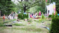 Model railroad and people in Sokolniki park at festival Stock Footage