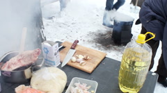 Preparation of ingredients for pilaff. Cleaned garlic cloves on a cutting board. Stock Footage
