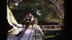 1957: Family riding amusement park classic car style ride railroad track. AKRON, Stock Footage