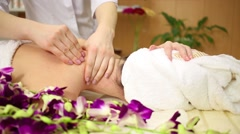 Masseuse massaging neck and shoulders of woman in white towels Stock Footage