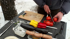 Preparation of sausages, tomatoes, egg-plants, bell peppers for the barbecue - stock footage