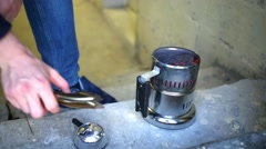 Mini burner with hot coals and hands removing cover from it close up. Stock Footage
